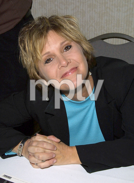 Carrie Fisher spent the weekend signing autographs for fans at the Hollywood Collectors show held at the Beverly Garland hotel in North Hollywood California.Lines were almost a four hour wait for the star. 1/20/02. © 2002 Glenn Weiner - Image 19812_0102