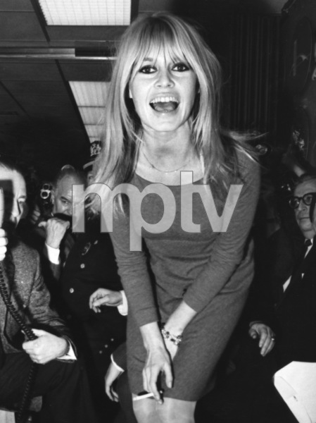 """Brigitte Bardot poses for newsmen after her arrival in New York for the American premiere of """"Viva Maria""""1965 - Image 2043_0037"""