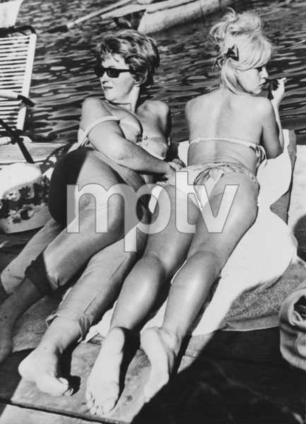 """Brigitte Bardot with Producer Christine Gouze-Renal during a pause in the shooting of """"A Very Private Affair"""" in Italy1961 - Image 2043_0160"""