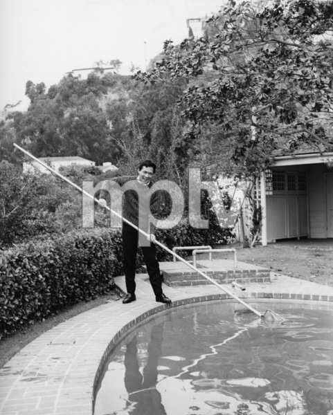 James Shigeta cleaning pool at his Georgian-Colonial home on top of the Hollywood Hillscirca 1956Photo by Joe Shere - Image 21096_0006