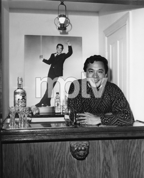 James Shigeta in the bar at his Georgian-Colonial home on top of the Hollywood Hillscirca 1956Photo by Joe Shere - Image 21096_0009