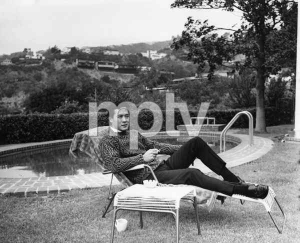 James Shigeta relaxing near pool at his Georgian-Colonial home on top of the Hollywood Hillscirca 1956Photo by Joe Shere - Image 21096_0010