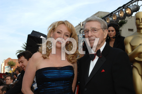 Best Supporting Actress Academy Award nominee Virginia Madsen poses with Army Archerd before the 77th Annual Academy Awards at the Kodak Theatre in Hollywood, CA on Sunday, February 27, 2005.  HO/AMPAS - Image 22270_0073