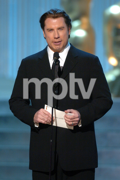 John Travolta presents the Academy Award for Best Original Score during the 77th Annual Academy Awards at the Kodak Theatre in Hollywood, CA on Sunday, February 27, 2005.  HO/AMPAS - Image 22270_0208