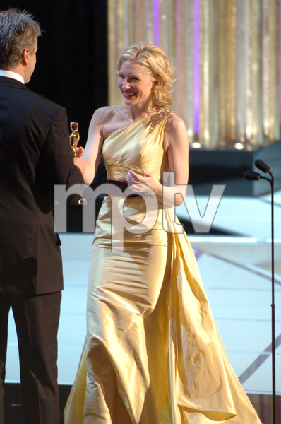 Cate Blanchett accepts the Academy Award for Best Actress from Oscar winner Tim Robbins during the 77th Annual Academy Awards at the Kodak Theatre in Hollywood, CA on Sunday, February 27, 2005.  HO/AMPAS - Image 22270_0265