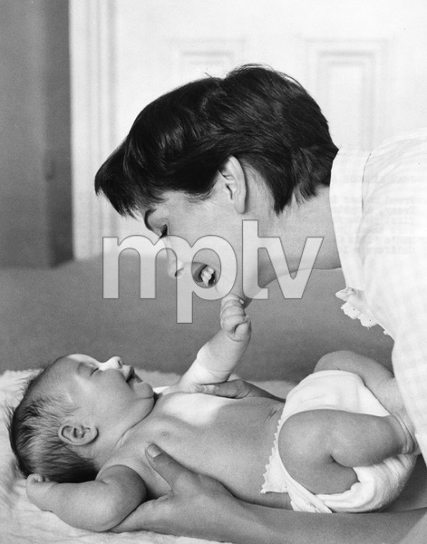 Jean Simmons and her first baby, mid 1950