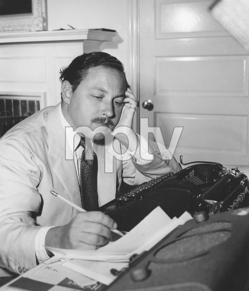 """Tennessee Williams writing the screenplay for the film version of """"THE GLASS MENAGERIE"""" 1950, I.V. - Image 22727_1041"""