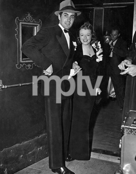 Janet Gaynor, with Tyrone Power, at a premiere, August, 1937 - Image 22727_1158