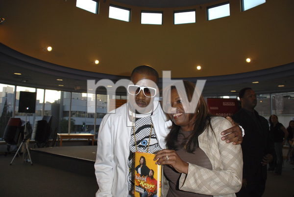 """Kanye West with mother Donda West at the book signing of """"Raising Kanye: Life Lessons from the Mother of a Hip-Hop Superstar"""" 05-09-2007 / Border"""