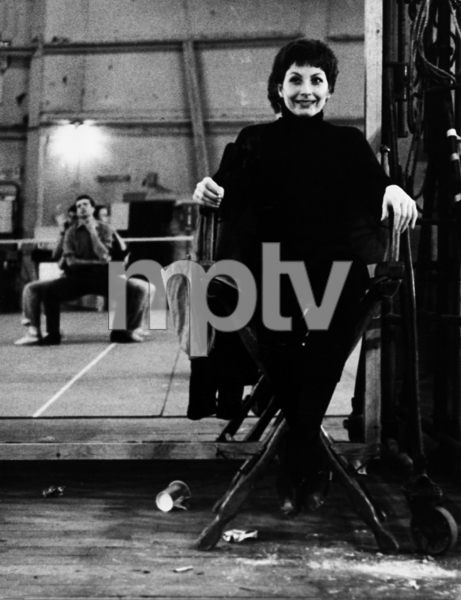"Zizi Jeanmaire rests, smoking a cigarette, during rehearsal for the film ""Anything Goes""1956 © 1978 Sanford Roth / AMPAS - Image 23124_0007"