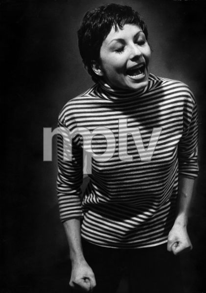 """Zizi Jeanmaire rehearses for her new film """"Anything Goes"""" (in this photo she is singing Cole Porter"""