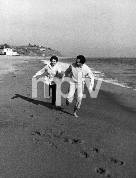 Zizi Jeanmaire with husband, Roland Petit, running along the beach - their morning exercise1956 © 1978 Sanford Roth / AMPAS - Image 23124_0012