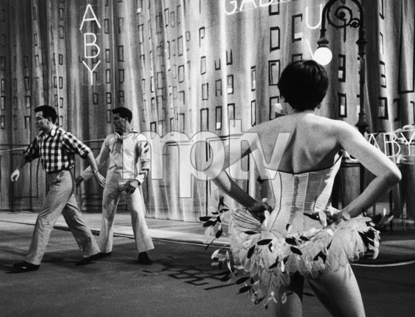 Zizi Jeanmaire in ballet dress seen from back, her husband in checked shirt (Roland Petit)1956 © 1978 Sanford Roth / AMPAS - Image 23124_0017