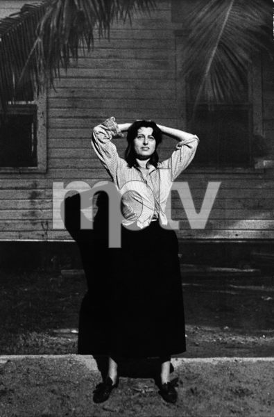"""The Rose Tattoo""Anna Magnani during a few minutes off from the scene in which she gives Burt Lancaster the silk rose-colored shirt1955 © 1978 Sanford Roth / AMPAS - Image 23129_0007"
