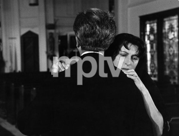 """""""The Rose Tattoo""""Anna Magnani, as Serafina, in church scene in which she pleads with priest to divulge whether her husband has ever spoken of another woman in his confessions1955 © 1978 Sanford Roth / AMPAS - Image 23129_0008"""