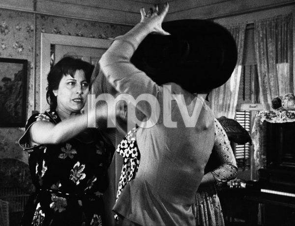 """""""The Rose Tattoo""""Anna Magnani in the scene with the two prostitutes who come for the blouse when Magnani is preparing to go to the graduation1955 © 1978 Sanford Roth / AMPAS - Image 23129_0009"""