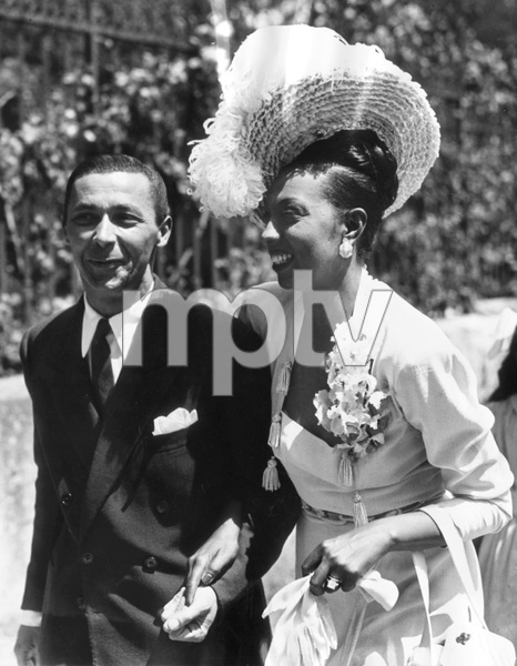 Josephine Baker and her new husband, Jo Bouillon, following their marriage ceremony in St. Cyprien, France 1947** I.V. - Image 23423_0016
