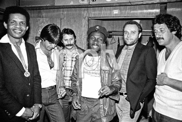 Jimmy Cliff backstage at the Roxy theater in West Hollywood firing up a joint after his concert circa late 1970s© 1978 Michael Jones - Image 23594_0013