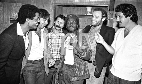 Jimmy Cliff backstage at the Roxy theater in West Hollywood firing up a joint after his concert circa late 1970s© 1978 Michael Jones - Image 23594_0014