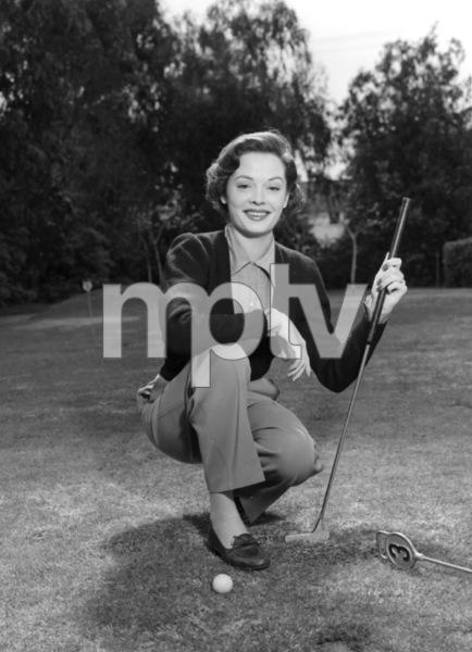 Jane Greer golfing, c. 1955.Photo by Paul Hesse - Image 2420_0002