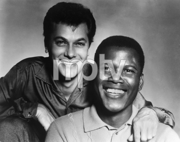 """Tony Curtis and Sidney Poitier during the making of """"The Defiant Ones""""1958 MGM** I.V. - Image 24287_0126"""