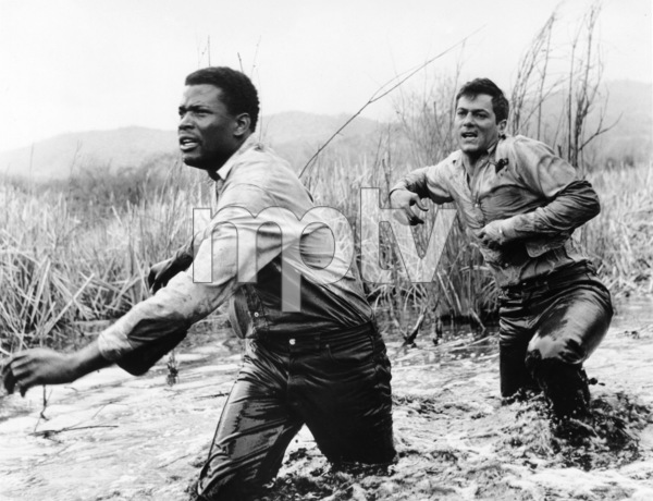 "Tony Curtis and Sidney Poitier during the making of ""The Defiant Ones""1958 MGM** I.V. - Image 24287_0127"