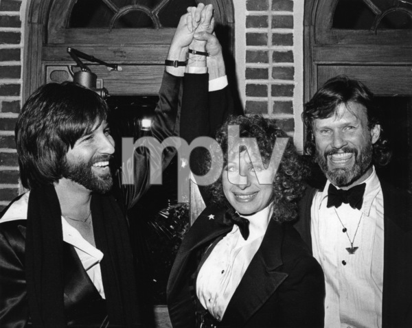 "Jon Peters, Barbra Streisand and Kris Kristofferson at the Tavern-on-the-Green after the New York premiere of ""A Star Is Born""December 23, 1976** B.D.M. - Image 24293_1675"
