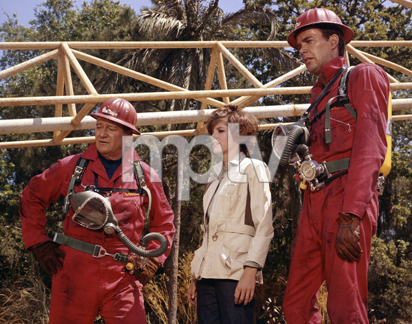 "John Wayne, Katharine Ross and Jim Hutton in ""Hellfighters""1968 Universal** B.D.M. - Image 24293_1894"