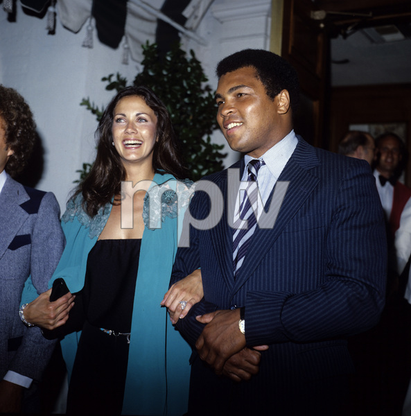 Lynda Carter and Muhammad Ali attending a dinner at Chasen