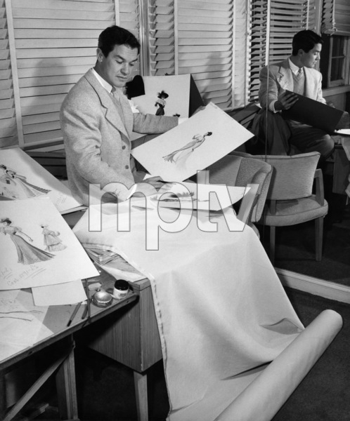 "Jean Louis with designs for Dorothy Lamour in ""Lulu Belle""1948© 1978 Ned Scott Archive - Image 24327_0026"