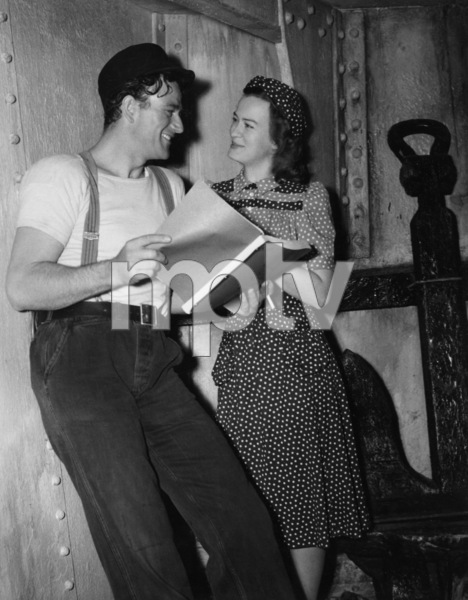 "John Wayne taking a dialect lesson from Osa Massen for his role in ""The Long Voyage Home""1940 UA© 1978 Ned Scott Archive - Image 24327_0038"
