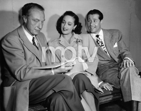 "Director Douglas Sirk, Dorothy Lamour and Don Ameche in ""Slightly French""1949 Columbia Pictures© 1978 Ned Scott Archive - Image 24327_0077"