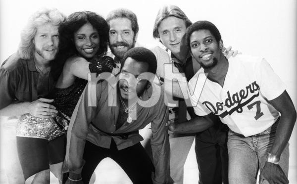 "Rufus and Chaka Khan (Bobby Watson, John ""J.R."" Robinson, Tony Maiden, Kevin Murphy, Chaka Khan, Dave ""Hawk"" Wolinski) during the making of two music videos for the album ""Masterjam""1979© 1979 Bobby Holland - Image 24331_0173"