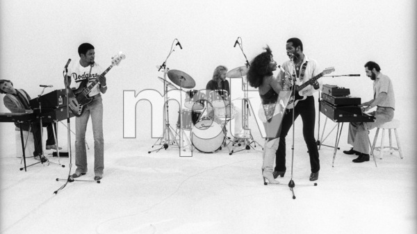 "Rufus and Chaka Khan (Bobby Watson, John ""J.R."" Robinson, Tony Maiden, Kevin Murphy, Chaka Khan, Dave ""Hawk"" Wolinski) during the making of two music videos for the album ""Masterjam"" 1979 © 1979 Bobby Holland - Image 24331_0240"