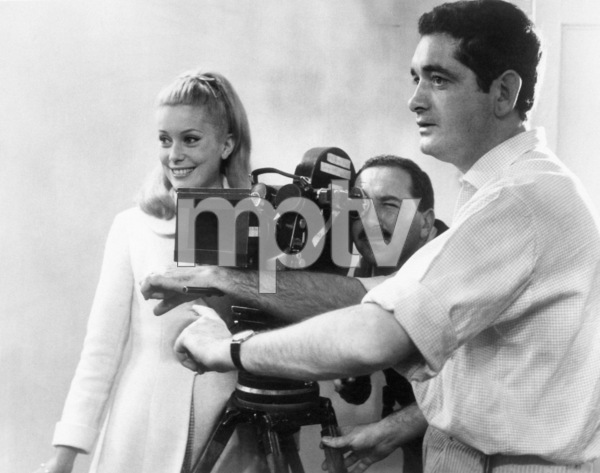 """Catherine Deneuve, cinematographerJean Rabier and director Jacques Demy on the set of """"The Umbrellas Of Cherbourg""""1964 ** I.V. - Image 24383_0335"""