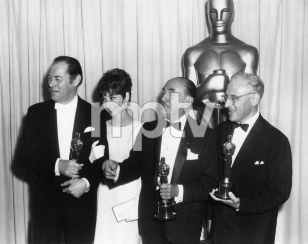 "Rex Harrison, Audrey Hepburn, Jack Warner and George Cukor pose with the Oscars they won for ""My Fair Lady"" at ""The 37th Annual Academy Awards"" at the Santa Monica Civic Auditorium in Santa Monica, California1965** B.D.M. - Image 24384_0077"