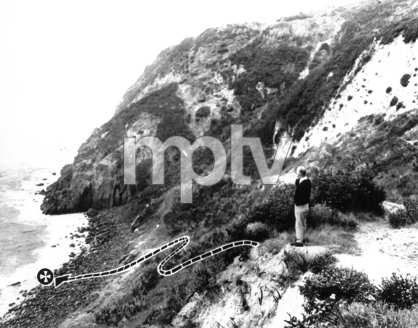 The broken line traces the path down which actress Jennifer Jones walked, and the cross indicates where her body was found in the surf on the rocks below Point Dume / 11-10-1967 - Image 2535_0103