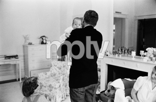 John F. Kennedy, John Kennedy Jr., Caroline Kennedy, Nanny Mrs. Maud Shaw at The White House nursery1961 © 2000 Mark Shaw - Image 2554_0034