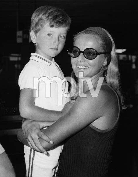 Virna Lisi embraces her son, Corrado, 6, on their arrival at Rome