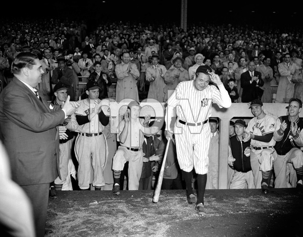 New York --  Babe Ruth tips his hat to the  cheering crowd which attended the Silver Anniversary ceremonies of the Yankee Stadium, June 13.  He hit the first homer in the stadium.  After the ceremonies, Ruth sent his uniform to baseball
