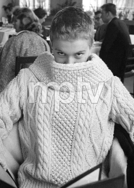 """Jean Seberg wearing photographer Bob Willoughby's Irish sweater at lunch in the Shepperton Studios commissary, during the filming of Otto Preminger's """"Saint Joan"""" in London 1957© 1978 Bob Willoughby - Image 2927_0100"""