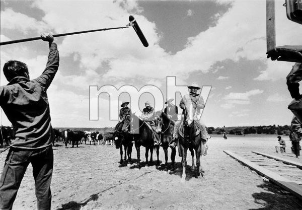 """""""The Cowboys,"""" Warner Bros. 1972.John Wayne and his boys during filming. - Image 3370_0001"""