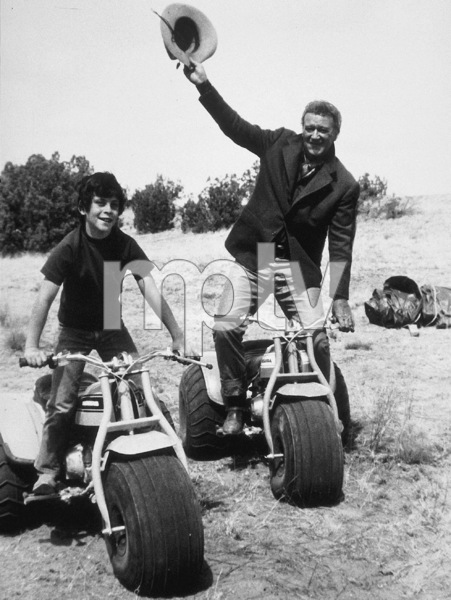 """""""The Cowboys,"""" Warner Bros. 1971.John Wayne and his son, Ethan, during a break from filming. © 1978 David Sutton - Image 3370_0020"""