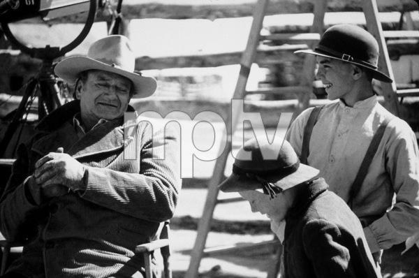 """The Cowboys,"" Warner Bros. 1971.John Wayne and two young actors on the set. © 1971 Bob Willoughby - Image 3370_0157"