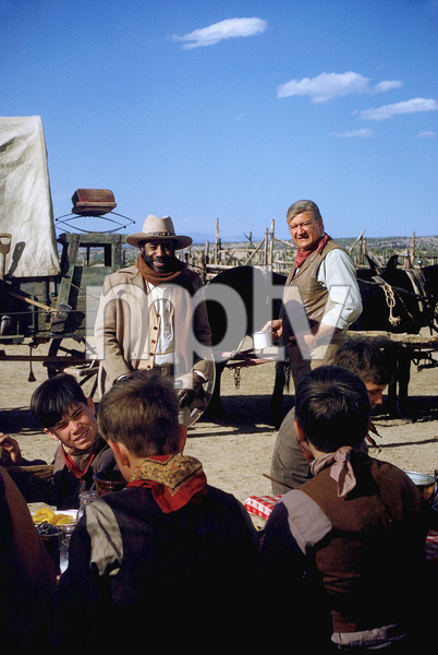 """The Cowboys,"" Warner Bros. 1971.Roscoe Lee Browne and John Wayne. © 1978 David Sutton - Image 3370_0163"