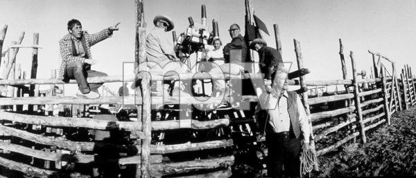 """The Cowboys"" Director, Mark Rydell, and John Wayne during filming © 1972 Warner Brothers - Image 3370_0578"