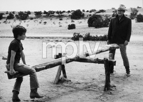 """""""The Cowboys,"""" Warner Bros. 1971.John Wayne and his son, Ethan, during a break from filming. © 1978 David Sutton - Image 3370_0603"""