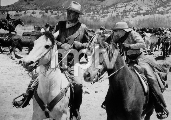 """The Cowboys,"" Warner Bros. 1971.John Wayne and Sean Kelly. © 1978 David Sutton - Image 3370_0605"
