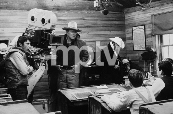 """The Cowboys,"" Warner Bros. 1971.Director, Mark Rydell, and John Wayne during filming. © 1978 David Sutton - Image 3370_0609"