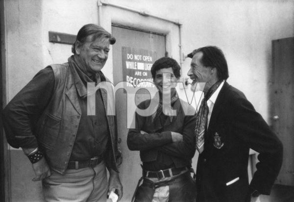 """The Cowboys""John Wayne, Robert Carradine and father John Carradine1972 Warner Brothers © 1978 David Sutton - Image 3370_0610"